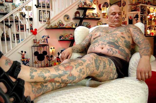 Tatooed man on the bigbed alone